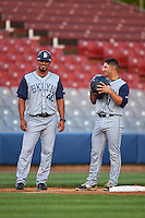 Brooklyn Cyclones hitting coach Yunir Garcia (40) and Vincent Siena (11) during the first game of a doubleheader against the Connecticut Tigers on September 2, 2015 at Senator Thomas J. Dodd Memorial Stadium in Norwich, Connecticut.  Brooklyn defeated Connecticut 7-1.  (Mike Janes/Four Seam Images)