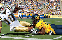 Marc Anthony brings down Ricky Marvray. The California Golden Bears defeated the UCLA Bruins 35-7 at Memorial Stadium in Berkeley, California on October 9th, 2010.