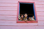 BUENOS AIRES - FEBRUARY 12: Children look out of a window in the La Boca neighborhood of Buenos Aires, Argentina on February 12, 2009.