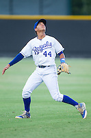 Burlington Royals shortstop Marten Gasparini (44) tracks a fly ball into shallow left field during the game against the Johnson City Cardinals at Burlington Athletic Park on July 14, 2014 in Burlington, North Carolina.  The Cardinals defeated the Royals 9-4.  (Brian Westerholt/Four Seam Images)