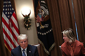 United States President Donald J. Trump, left, listens as US Ambassador to the United Nations Kelly Kraft, right, speaks during a luncheon with the Permanent Representatives of the United Nations Security Council in the Cabinet Room of the White House on December 5, 2019 in Washington, DC.<br /> Credit: Oliver Contreras / Pool via CNP