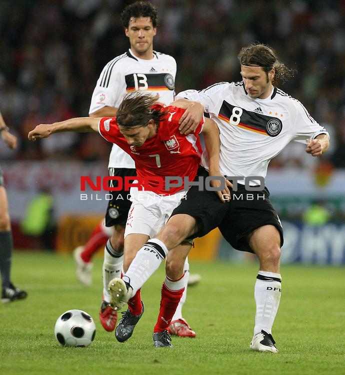 UEFA Euro 2008 Group B Klagenfurt - WŲrthersee Match 04. <br /> Ebi Smolarek ( Poland / Angreifer / Forward / Racing Santander #07 ) (l) im Kampf um den Ball mit Torsten Frings ( Germany / Mittelfeldspieler / Midfielder / Werder Bremen #08 ) (r).<br /> Foto &copy; nph (  nordphoto  )