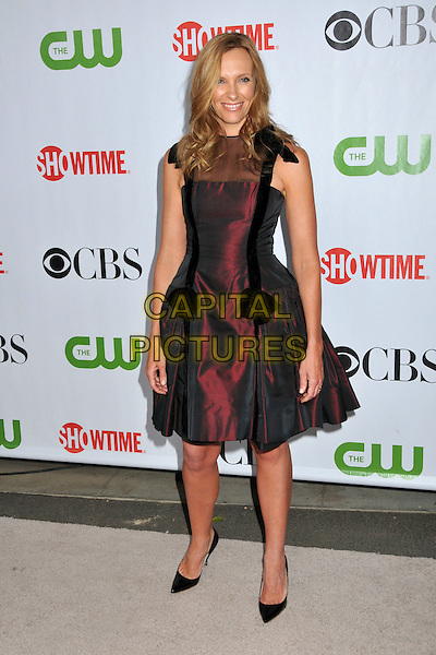 TONI COLLETTE.CBS, CW and Showtime TCA Press Tour Party 2009 held at the Huntington Library, Pasadena, CA, USA..August 3rd, 2009.full length black sheer red pink black two tone bows .CAP/ADM/BP.©Byron Purvis/AdMedia/Capital Pictures.