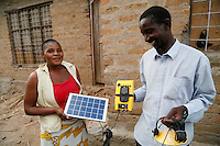 Mecktilda and Stefano became local agents for Global Cycle Solutions, a solar energy provider, in their village near Mwanza, Tanzania, last year. They bought one sample solar lighting kit for 100,000 Tanzanian schillings (about &pound;30). They then persuaded   others in their community to buy the kits, and with each sale they make a small commission. They've now sold over 200 solar kits, and are earning enough money to cover their children's school fees. They now plan to build a separate building next door to their house  to use as a shop to sell the solar kits from.<br /> <br /> Picture: Russell Watkins/Department for International Development