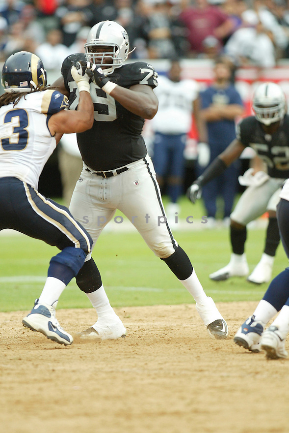 JOHN HENDERSON, of the Oakland Raiders, in action during the Raiders  game against the St. Louis Rams on September 19, 2010 at Oakland-Alameda County Stadium in Oakland, California...The Raiders beat the Rams 16-14