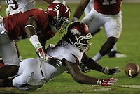 Arkansas Democrat-Gazette/BENJAMIN KRAIN --10/10/15--<br /> Damon Mitchell and Alabama's Cyrus Jones scramble for possession of an Arkansas insides kick near the end of the Razorbacks 27-14 loss.