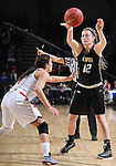 SIOUX FALLS, SD - MARCH 9: Caitlyn Tolen #12 of IUPUI passes the ball against defender Tia Hemiller #4 of USD in the first half of their semi-final round Summit League Championship Tournament game Monday afternoon at the Denny Sanford Premier Center in Sioux Falls, SD. (Photo by Dick Carlson/Inertia)