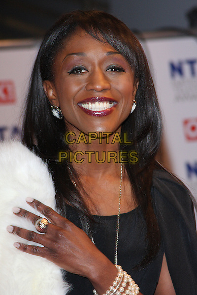 DIANE PARISH.The 15th National Television Awards held at the O2 Arena, London, England. .January 20th, 2010 .NTA NTAs headshot portrait hand gold ring smiling white fur black make-up.CAP/ROS.©Steve Ross/Capital Pictures.