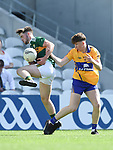 David Mangan of Kerry in action against Cillian Rouine of Clare during their Munster Minor football final at Pairc Ui Chaoimh. Photograph by John Kelly.