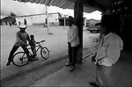 Zapotec Native neighbors gather around to talk on a street in Coatecas Altas village, Oaxaca, November 22, 1998. Most of the villagers of Coatecas leave their home to harvest in northern state of Sinaloa.  © Photo by Heriberto Rodriguez