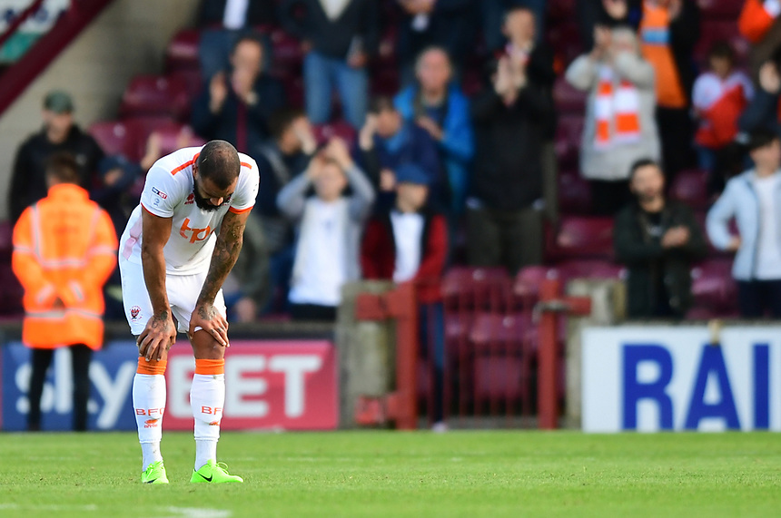 Blackpool's Kyle Vassell reacts at the final whistle<br /> <br /> Photographer Chris Vaughan/CameraSport<br /> <br /> The EFL Sky Bet League One - Scunthorpe United v Blackpool - Saturday 9th September 2017 - Glanford Park - Scunthorpe<br /> <br /> World Copyright &copy; 2017 CameraSport. All rights reserved. 43 Linden Ave. Countesthorpe. Leicester. England. LE8 5PG - Tel: +44 (0) 116 277 4147 - admin@camerasport.com - www.camerasport.com