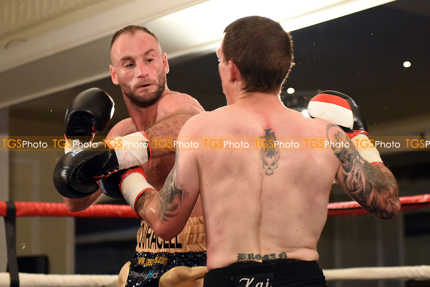 Ben Jones (gold shorts) defeats Michael Stupart during a Boxing show at the Rockingham Forest Hotel, Corby, England on 11/09/2015