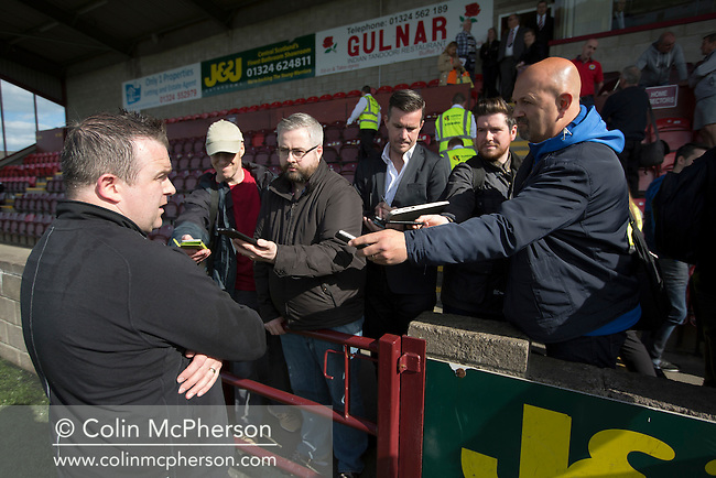 Victorious visiting manager Gary Jardine being interviewed by the press after East Stirlingshire hosted Edinburgh City in the second leg of the Scottish League pyramid play-off at Ochilview Park, Stenhousemuir. The play-offs were introduced in 2015 with the winners of the Highland and Lowland Leagues playing-off for the chance to play the club which finished bottom of Scottish League 2. Edinburgh City won the match 1-0 giving them a 2-1 aggregate victory making them the first club in Scottish League history to be promoted into the league.