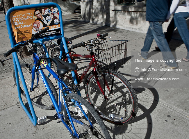 Advertising is displayed on a bike rack in downtown Ottawa Saturday September 25, 2010.