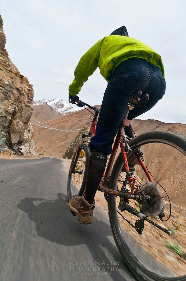 Point of View POV photo of mountain biking on the highest motorable road in the world,  Himalayan Mountains, Ladakh, India.