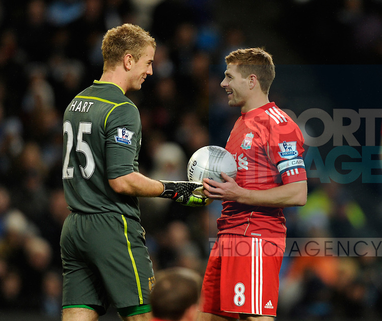 Joe Hart of Manchester City and Steven Gerrard of Liverpool exchange words before the penalty kick.The Carling Cup, Semi Final 1st leg.Manchester City v Liverpool at the Etihad Stadium, Manchester..11th January, 2012.--------------------.Sportimage +44 7980659747.picturedesk@sportimage.co.uk.http://www.sportimage.co.uk/.Editorial use only. Maximum 45 images during a match. No video emulation or promotion as 'live'. No use in games, competitions, merchandise, betting or single club/player services. No use with unofficial audio, video, data, fixtures or club/league logos.