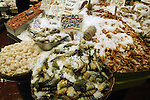 Fish, shellfish, shrimp and crabs for sale at Pike Place Market in Seattle.  For over a century a century, the Pike Place Market, has become a city institution and a national attraction, bringing in over a million tourists a year. .Jim Bryant Photo. ©2010. ALL RIGHTS RESERVED.