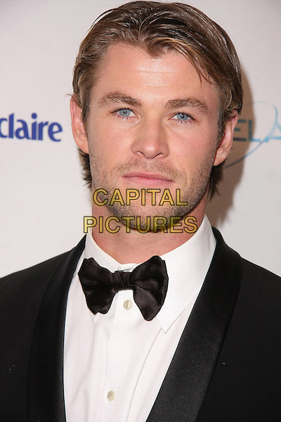 CHRIS HEMSWORTH.Relativity Weinstein Company 68th Annual Golden Globe Awards After Party Presented by Marie Claire held at the Beverly Hilton, Beverly Hills, California, USA..January 16th, 2011.headshot portrait bow tie stubble facial hair  black white tuxedo .CAP/ADM/TB.©Tommaso Boddi/AdMedia/Capital Pictures.