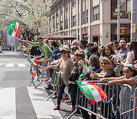 Iranian-Americans and supporters watch the 11th annual Persian Parade on Madison Ave. in New York on Sunday, April 13, 2014. The parade celebrates Nowruz, New Year in the Farsi language. The holiday symbolizes the purification of the soul and dates back to the pre-Islamic religion of Zoroastrianism. (© Richard B. Levine)