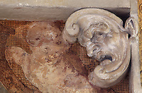 Face of a satyr in carved stucco and fresco of a putto, from the frame of the fresco of Cleobis and Biton, by Rosso Fiorentino, 1535-37, in the Galerie Francois I, begun 1528, the first great gallery in France and the origination of the Renaissance style in France, Chateau de Fontainebleau, France. The Palace of Fontainebleau is one of the largest French royal palaces and was begun in the early 16th century for Francois I. It was listed as a UNESCO World Heritage Site in 1981. Picture by Manuel Cohen