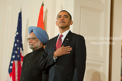 Washington, DC - November 24, 2009 -- United States President Barack Obama places his hand on his heart as the national anthem is played during the State Arrival ceremony for Prime Minister Manmohan Singh of India, and his wife, Mrs Gursharan Kaur, in the East Room of the White House, November 24, 2009..Mandatory Credit: Samantha Appleton - White House via CNP