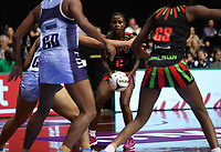 24.02.2018 Malawi's Takondwa Lwazi in action during the Malawi v Fiji Taini Jamison Trophy netball match at the North Shore Events Centre in Auckland. Mandatory Photo Credit ©Michael Bradley.