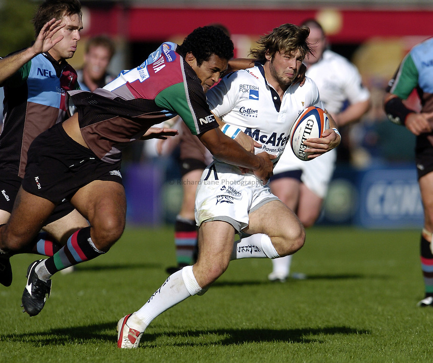 Photo: Olly Greenwood..NEC Harlequins v Sale Sharks. EDF Anglo-Welsh Cup. 07/10/2006. Sale's Ben Foden is tackled by Quins Chris Hala'ufia.
