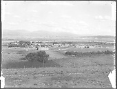 A rather distant view of Santa Clara Pueblo in 1905 with the D&amp;RG Santa F? Branch track in the foreground.<br /> D&amp;RG  Santa Clara Pueblo, NM  Taken by Curtis, Edward S. - 1905