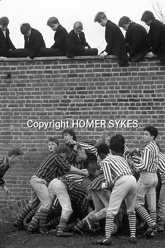 Eton college school, near nr Windsor Berkshire. England The Wall Game.<br /> <br /> The Eton Wall Game played on The Furrow next to the wall that gives the game its name. An aggressive form of football played between Collegers and the rest of the school, who are called Oppidans.  Goals are rarely scored.