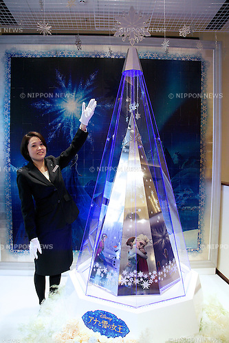"A staff poses for the cameras next to the ""Disney Platinum Christmas Tree"" made of platinum at Ginza Tanaka jewelry store in Ginza, Tokyo on November 19, 2014. The large version of the Disney tree is made of platinum and decorated with the characters of the worldwide hit movie Frozen. It has a 2.6 meter height and 31kg weight and it costs approximately 2.6 million USD. The small silver version costs 4000 USD and both are on sale from November 19.  (Photo by Rodrigo Reyes Marin/AFLO)"