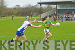 Sarah Houlihan (Kerry) get the ball away as G Enright (Waterford) tries a block in the Ladies National Football League on Sunday at Castleisland Desmond GAA grounds .....