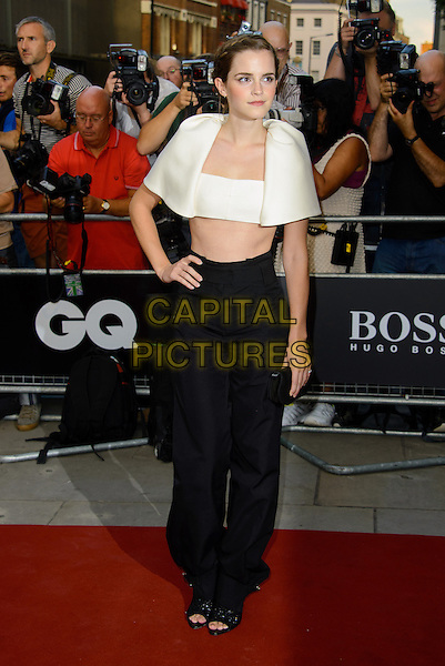 Emma Watson<br /> GQ Men of the Year Awards 2013 at the Royal Opera House, London, England.<br /> 3rd September 2013<br /> full length black white cropped top cape belly stomach midriff trousers hand on hip<br /> CAP/CJ<br /> &copy;Chris Joseph/Capital Pictures