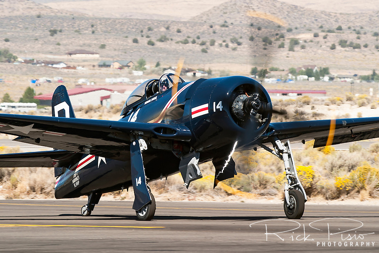 """Howard Pardue taxies the F8F Bearcat """"Kimberly Kaye"""" during the 2004 Reno Air Races. BuNo 88458 was one of the first two prototypes ordered by the U.S. Navy in 1943. The Bearcat entered the Navy's air squadrons to late to see action in World War II. In  April of 2012 Howard crashed while on takeoff losing his life and destroying the aircraft."""