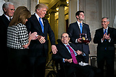 U.S. President Donald Trump greets former Senator Bob Dole as he is presented with the congressional Gold Medal, by U.S. House Speaker Paul Ryan, a Republican from Wisconsin, at the U.S. Capitol, in Washington D.C., U.S., on Wednesday, Jan. 17, 2018. From left: U.S. Vice President Mike Pence, Congresswoman Lynn Jenkins, a Republican from Kansas, Trump, Dole, Ryan, and Senate Majority Leader Mitch McConnell, a Republican from Kentucky. Photographer: Al Drago/Bloomberg<br /> Credit: Al Drago / Pool via CNP