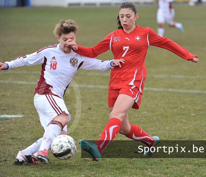 Switzerland U19 - Russia U19 : Carmen Pulver in a duel with Darya Kitsa (18).foto DAVID CATRY / Nikonpro.be