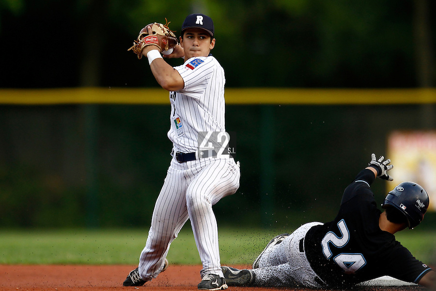 15 July 2011: Maxime Lefevre of the Rouen Huskies throws to first for the double play during the 2011 Challenge de France match won 6-5 by the Rouen Huskies over the Senart Templiers at Stade Pierre Rolland, in Rouen, France.