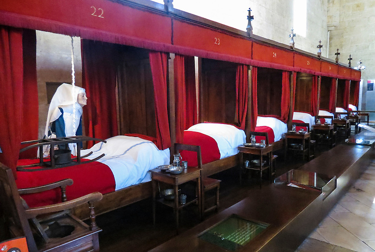 "VMI Vincentian Heritage Tour: Members of the VMI tour the ""Room for the Poor"" inside the Hospices de Beaune or Hôtel-Dieu de Beaune, Wednesday, June 29, 2016. The hospital is a former charitable almshouse in Beaune, France. It was founded in 1443 by Nicolas Rolin, chancellor of Burgundy, as a hospital for the poor. (DePaul University/Jamie Moncrief)"