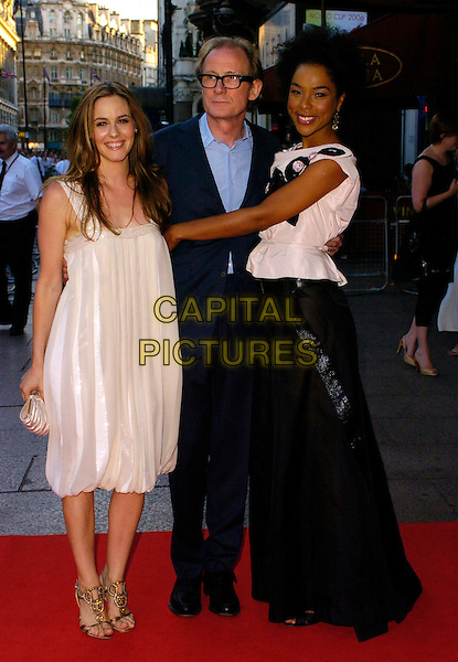 "ALICIA SILVERSTONE, BILL NIGHY & SOPHIE OKONEDO.The ""Stormbreaker"" world premiere at Vue West End, London, UK..July 17th, 2006.Ref: CAN.full length white shimmery dress pleated pleats jewelled clutch bag wide shoulder straps blue suit gold shoes black skirt top.www.capitalpictures.com.sales@capitalpictures.com.©Capital Pictures"