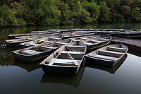 View of row boats in the lake in New York City's Central Park in the fall.