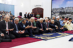 Palestinian President Mahmoud Abbas and his Prime Minister Rami Hamdallah perform Eid al-Fitr prayer in the West Bank city of Ramallah on June 15, 2018. Muslims worldwide celebrate Eid al-Fitr marking the end of the fasting month of Ramadan. Photo by Thaer Ganaim
