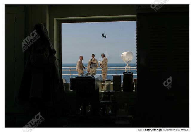 "Marine guards on patrol on the ""bridge."" USNS COMFORT Naval hospital ship in the Persian Gulf."