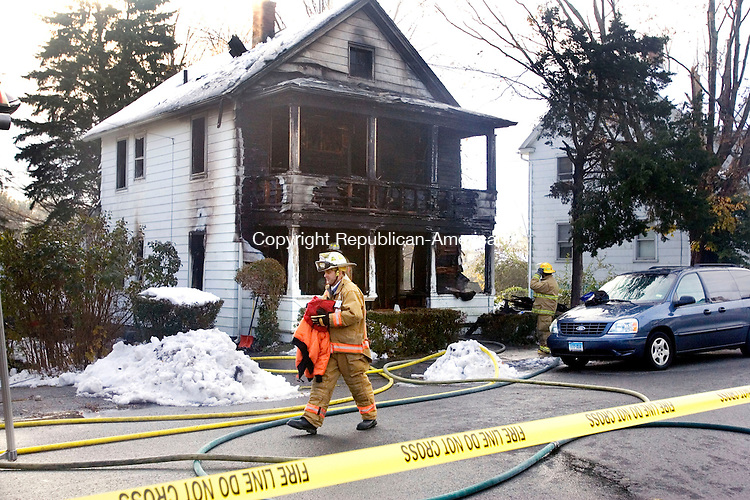 TORRINGTON, CT. 01 November 2011-110111SV04--Firefighters and investigators sift through the rubble of an early morning fire that ripped through a 101-year-old home at 40 Red Mountain Ave in Torrington Tuesday. The occupants were displaced. No one was injured.<br /> Steven Valenti Republican-American