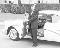 Dr. E.H. Hereford beside car, no date; Arlington State College president 1948-1958