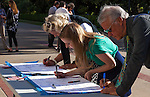 The Alliance Francaise de Sacramento held a vigil for the Nice massacre victims at the California State Capitol on Monday, July 18, 2016.  The Sacramento French Honorary Consul Guy Michelier spoke to the crowd, asked for a moment of silence, followed by singing La Marseillaise the national anthem of France.  People were invited to sign and write their thoughts on poster boards.  The vigil was held for the victims of the Bastille Day, July 14, 2016, attack in France.  Photo/Victoria Sheridan