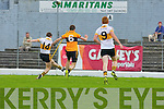 Kieran O'Leary (14) drives home Crokes  goal against Stacks in Killarney on Sunday despite Stacks Daniel Bohane
