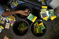 Social Advocates for Youth (SAY) horticulturist Eddie Casarez sorts seed packets in preparation for another round of planting at the SAY Sunflower Community Garden in Santa Rosa, Calif., on May 14, 2013. (Photo by Alvin Jornada)