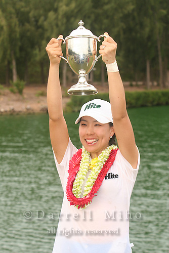 February 18, 2006; Kahuku, HI - Joo Mi Kim raises her trophy during the awards ceremony after winning the LPGA SBS Open at Turtle Bay Resort...Mandatory photo credit: Darrell Miho.© Darrell Miho