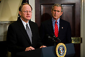 Washington, D.C. - January 5, 2007 -- Vice Admiral Mike McConnell makes remarks after being as United States President George W. Bush looks on after being named to replace John Negroponte as director of national intelligence.  Negroponte will become the Deputy Secretary of State under Condoleezza Rice. <br /> Credit: Jay L. Clendenin - Pool via CNP