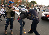 After numerous warnings to refrain from marching in the street, a Santa Rosa police officer arrests demonstrator David Douglass who was walking in the northbound lanes of Mendocino Avenue during a protest march over the shooting death of Andy Lopez in Santa Rosa, Calif., on November 26, 2013. Lopez, a 13-year-old, was shot and killed by a Sonoma County sheriff's deputy on October 22, 2013 , while he was walking with an airsoft pellet gun that resembled an AK-47 assault rifle. (Alvin Jornada / The Press Democrat)