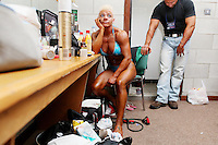 23/10/2010. Irish female physique and figure fitness national championships.  Angela Mc Namara (2nd place winner) from Limerick is pictured pumping up backstage during the female physique category as part of the 2010 RIBBF national bodybuilding championships at the University of Limerick Concert Hall, Limerick, Ireland. Picture James Horan.